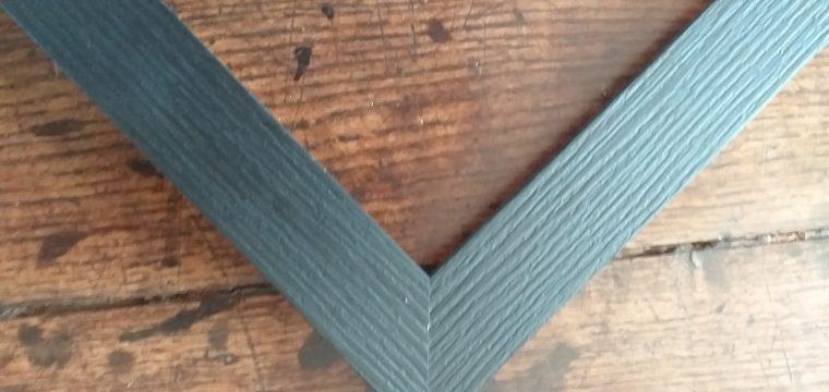 grained black frame